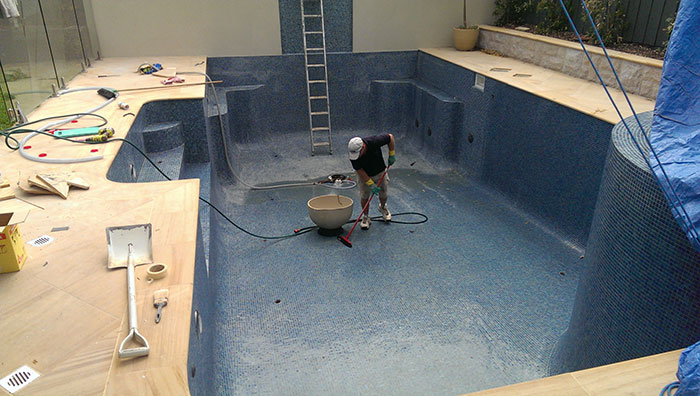 final touches to pool